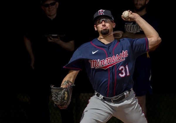 Twins pitcher Devin Smeltzer threw in the bullpen during a spring training workout.