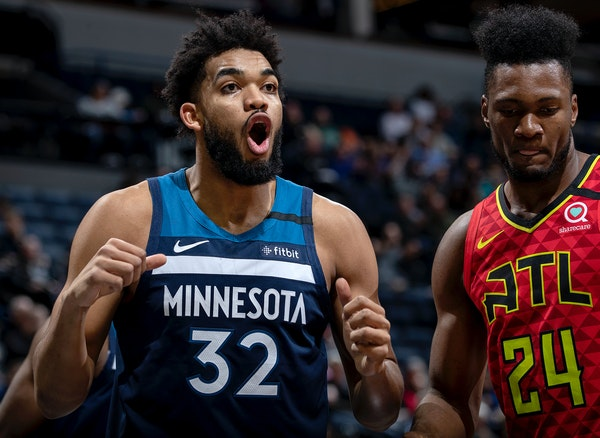 The Timberwolves' Karl-Anthony Towns reacts after being called for a foul in the first half against the Hawks at on Feb. 5 at Target Center