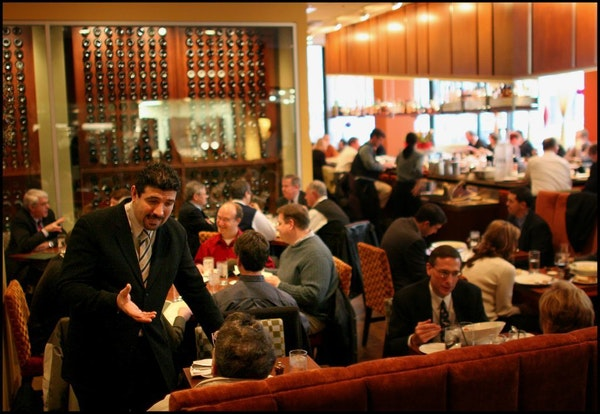 In this file photo from 2004, Anoush Ansari seats a customer in an already full Mission American dining room.