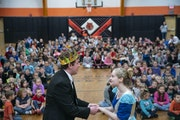 Wesley Frye, left, as Prince Charming, and Madison Holtze, as Cinderella, performed a scene at the royal ball for students from Cherry School.