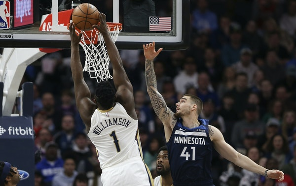 The Pelicans' Zion Williamson soared for a dunk against Timberwolves forward Juancho Hernangomez in the first half Sunday.