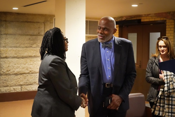 Former Minnesota Supreme Court Justice Alan Page paused to talk with Rep. Rena Moran, DFL-St. Paul, a supporter of the amendment.