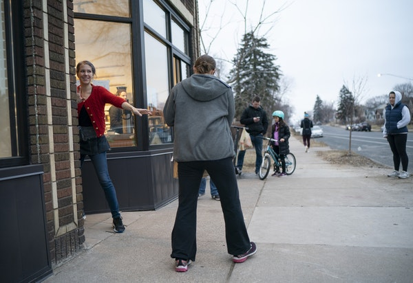 Heather's staffer Zoey Brom-Palkowski handed a takeout order to one of the several customers waiting outside the south Minneapolis restaurant Wednesda