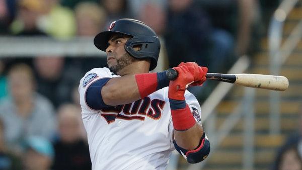 Twins designated hitter Nelson Cruz follows through on a single in the first inning of a spring training game Feb. 29