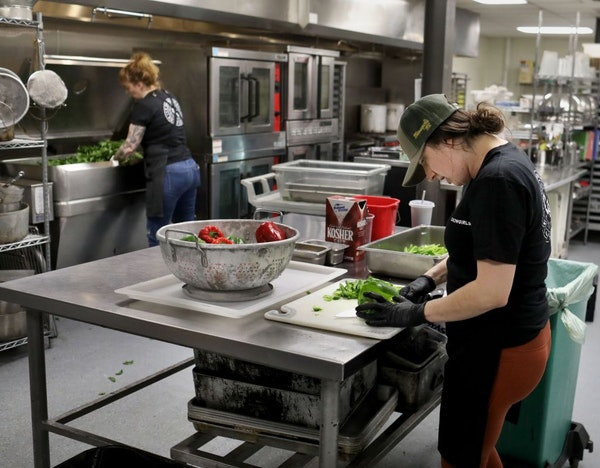 Kate Kiernoziak, Chowgirls Killer Catering sous chef, right, and Arianna Baker-Kern, Chowgirls Killer Catering chef de cuisine, prepare ingredients fo