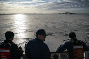 Crewmen on the USCGC Alder looked out at the large chunks of ice floating in the Duluth Bay on Tuesday morning.
