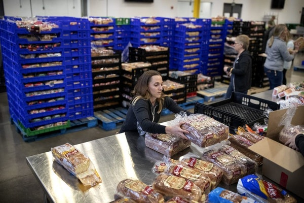 Volunteer Kimberly Lawrence of Rosemount packed loaves of bread at Second Harvest Heartland, the state's largest food bank. Staffers and volunteers