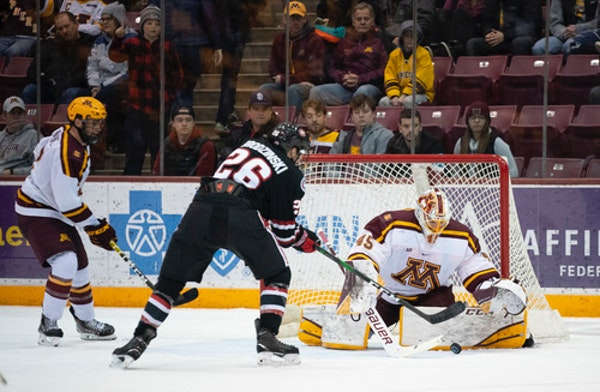 Gophers goalie Jack LaFontaine denied St. Cloud State's Easton Brodzinski during Minnesota's victory in the Mariucci Classic championship game.