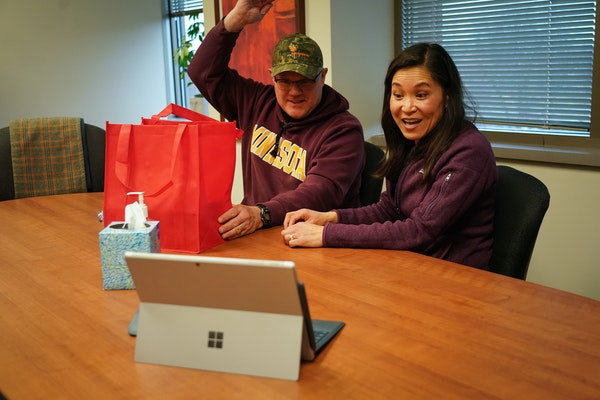 At their house closing, Mark Wollschlager and Julie Huang greeted Realtor Kath Hammerseng, who was available on a live video session on a portable ele
