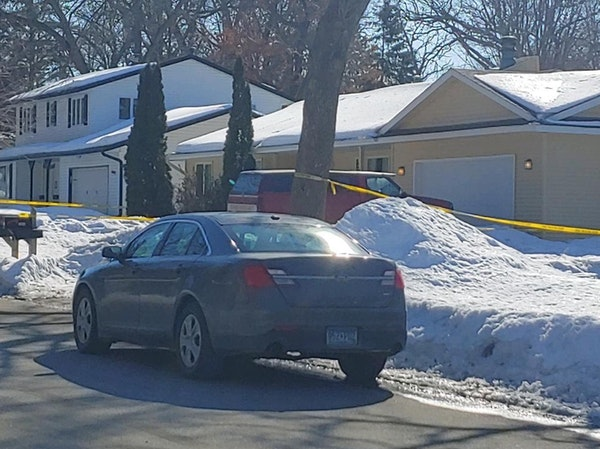 Crime scene tape surrounded the yellow home where a man was fatally shot by Dakota County deputies serving a search warrant in Lakeville.