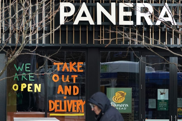 Signs alerting customers to changes in operations were painting on the windows of Panera Saturday on Nicollet Mall.