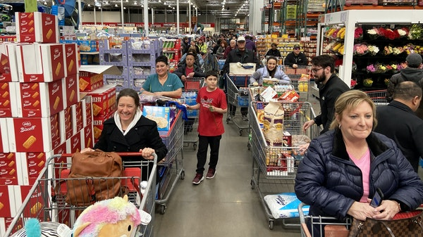 Shoppers flooded Costco caused a checkout line at the Maple Grove Costco to stretch to the back of the store Friday.