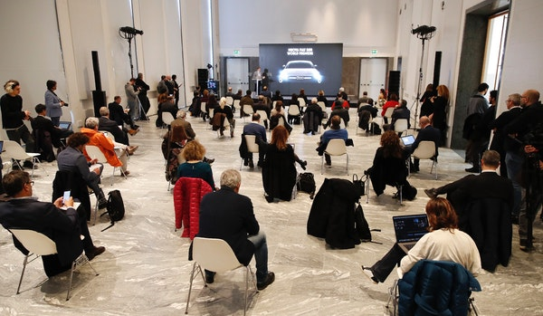 People sat a recommended distance apart from each other during the presentation of the new FIAT 500 electric car in Milan on Wednesday, March 4, 2020.