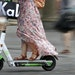 A woman rides an electric scooter. Transit options like these work best in summer, a letter writer says.
