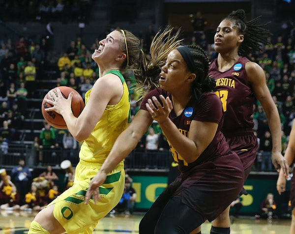 Oregon standout guard Sabrina Ionescu, left, was fouled by the Gophers' Gadiva Hubbard during the second half of Sunday night's game.