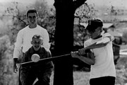 In this photo from the spring of 1957, John Teresi, left, in his role as umpire, oversaw a YMCA youth program softball game in Golden Valley. Teresi w
