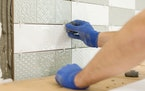Learning to install tile is a popular project that's searched for on YouTube.