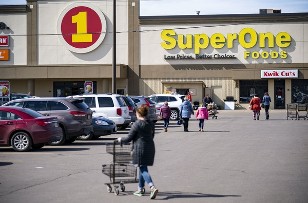 The parking lot of a Super One in Superior was full on Monday afternoon, even after the mayor advised residents to avoid shopping as newly confirmed c