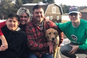 The family of Hill-Murray hockey player Charlie Strobel. From left, brother Ryan, mother Jill, father Mike, Chevy the dog, Charlie. Submitted family p
