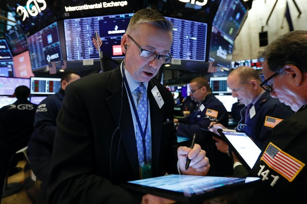 Trader Neil Catania works on the floor of the New York Stock Exchange on Friday when the markets ended with the worst week since 2008.