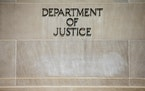 FILE - In this June 19, 2015, file the Justice Department Building in Washington. The Justice Department says pharmaceutical company Sandoz Inc. will