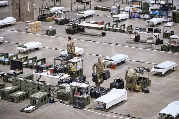 Army soldiers from Fort Carson and Fort Lewis are setting up a field hospital for non-COVID-19 patients at CenturyLink Field Events Center in Seattle.