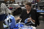 Service Manager Keith Wilson tests a TV100 ventilator at medical equipment manufacturer Bio-Med Devices in Guilford, Conn. on Sunday, March 29, 2020.