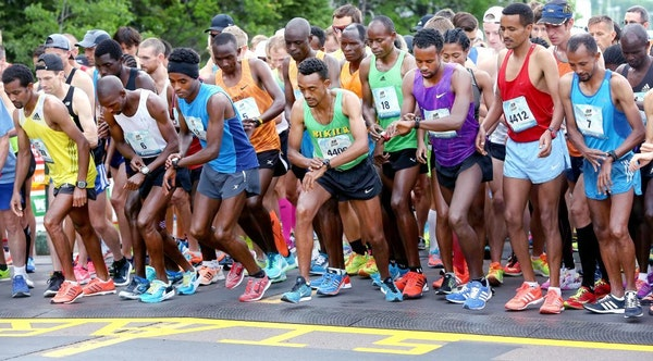 Elite runners set their watches as they took at the start of Grandma's Marathon in June 2017.
