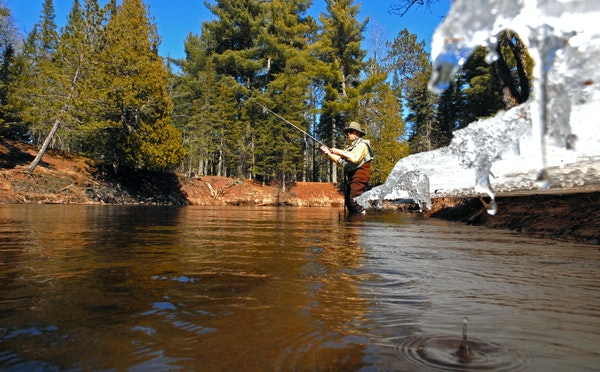 FILE-Wisconsin officials are urging residents not to travel to this weekend's Brule River steelhead fishing opener.