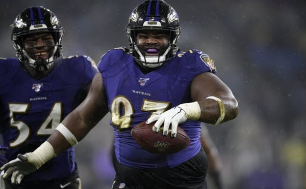 Ravens defensive tackle Michael Pierce celebrates his fumble recovery with linebacker Tyus Bowser during a game against the Steelers on Dec. 29