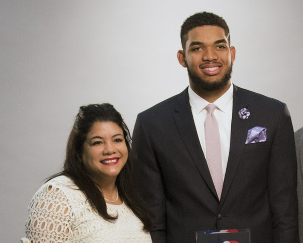 Karl-Anthony Towns had his mother at his side in a photo taken after he was named the NBA's top rookie in 2016.