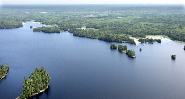 Aerial view looking over Birch Lake toward the site of the Twin Metals underground mine.