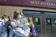 Members of the Rochester Lourdes girls' basketball team hugged after the MSHSL announced the cancellation of the state tournament on March 13. No prep