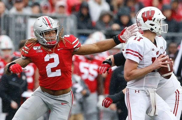 Ohio State defensive end Chase Young pressures Wisconsin quarterback Jack Coan on Oct. 26, a game the Buckeyes dominated. The teams meet again Saturda