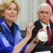 Dr. Deborah Birx, White House coronavirus response coordinator, holds a 3M N95 mask as she and Vice President Mike Pence visited 3M headquarters in Ma
