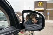 Colton Rebarich worked on choir homework while his mom, Nancy, checked her phone while parked outside a McDonalds in Virginia, Minn. They go there twi