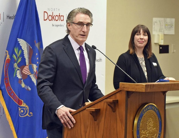 North Dakota Gov. Doug Burgum speaks on the growing number of COVID-19 cases during a press conference, Friday, March 20, 2020 in Bismarck, N.D.. At r