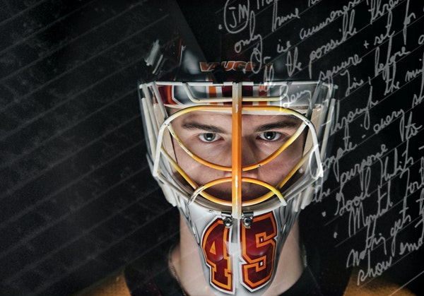 Gophers goalie Jack LaFontaine is an English major, shown here in a double exposure with an image of his journal in the background.