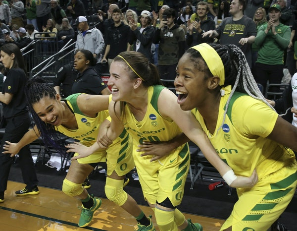 Oregon standouts Sabrina Ionescu, center, and Satou Sabally, left, figure to be two of the top three picks in the upcoming WNBA draft. Might Ruthy Heb