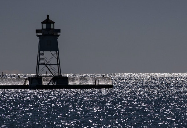 Grand Marais Lighthouse stood tall among the sparkling waters of Lake Superior.