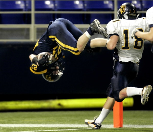 Micah Koehn finished his game-winning touchdown for Totino-Grace with a flip during the 4A title game of the 2007 Prep Bowl.