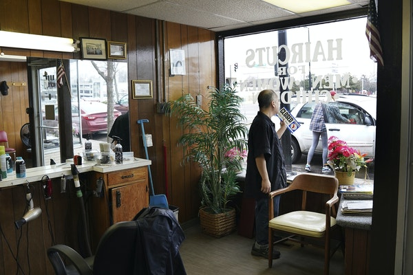 Mike Stevenson flipped his barber shop sign to closed after learning state regulators had clarified that hair and nail salons, spas and other similar