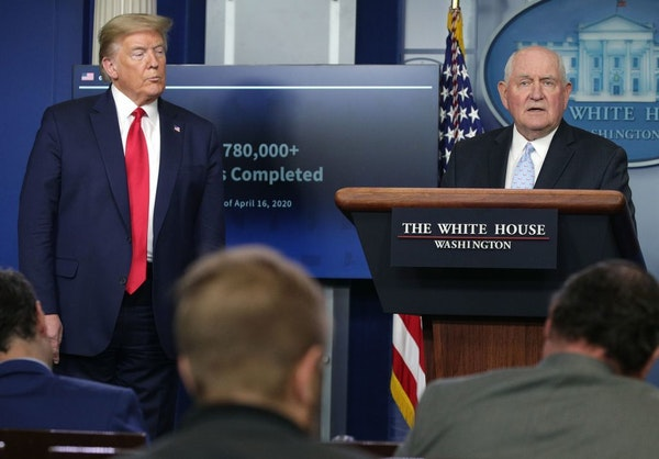 Secretary of Agriculture Sonny Perdue, right, speaks as President Donald Trump looks on during the daily briefing of the White House Coronavirus Task