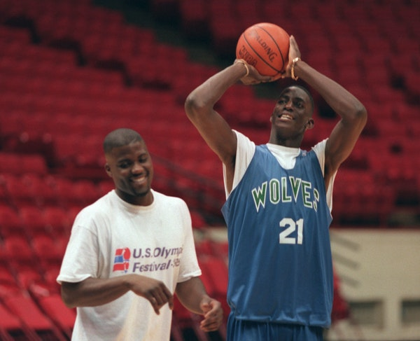 Wolves rookie Kevin Garnett shoots after practice with JR Rider at the Target Center in 1995.