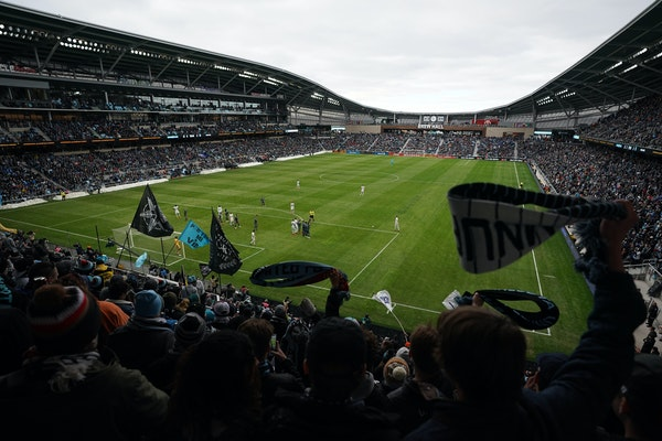 Minnesota United fans waved their scarves during a game last April.