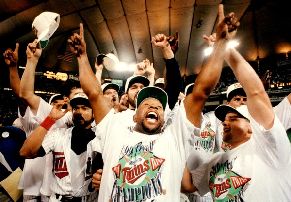 Kirby Puckett celebrated the Twins' second World Series championship with teammates in 1991