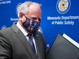 Minnesota Gov. Tim Walz wore a Twins-themed face mask in and out of the press conference to announce the state's new testing strategy in late April 20