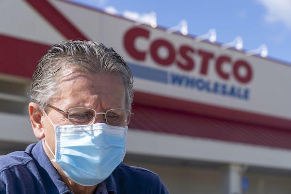Shopper Dobro Hajek wore a mask at a Costco store in Palm Beach Gardens, Fla.