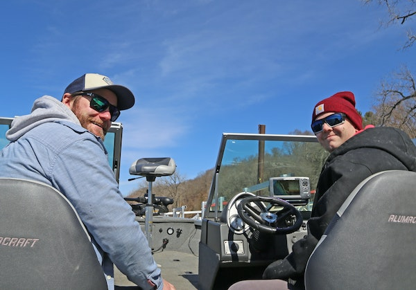 Jake Wallner, left, of St. Paul and his buddy Adam Bergstrom of Farmington set off Tuesday on the Misssissippi River in Bergstrom's new boat, launch