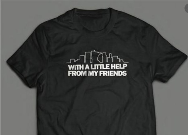 """T-shirts reading """"With a Little Help From My Friends"""" went on sale last month to benefit the Twin Cities Music Community Trust."""